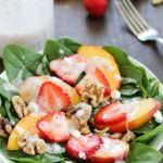 Spinach Salad with strawberries, peaches, candied walnuts, goat cheese and a crazy good (and crazy easy) homemade poppyseed dressing! PLUS a Blendtec Giveaway!