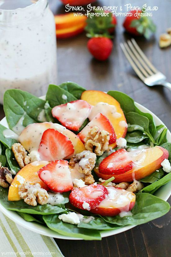 Spinach Salad with strawberries, peaches, candied walnuts, goat cheese and a crazy good (and crazy easy) homemade poppyseed dressing!