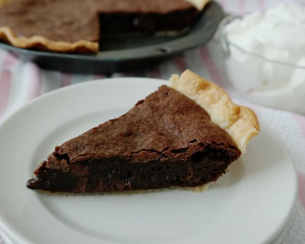 Easy Brownie Pie- taking brownies to the next level and creating an easy dessert-a flaky pie crust surrounds a rich brownie with a thin crust on top and in the middle a gooey, fudgy delight!