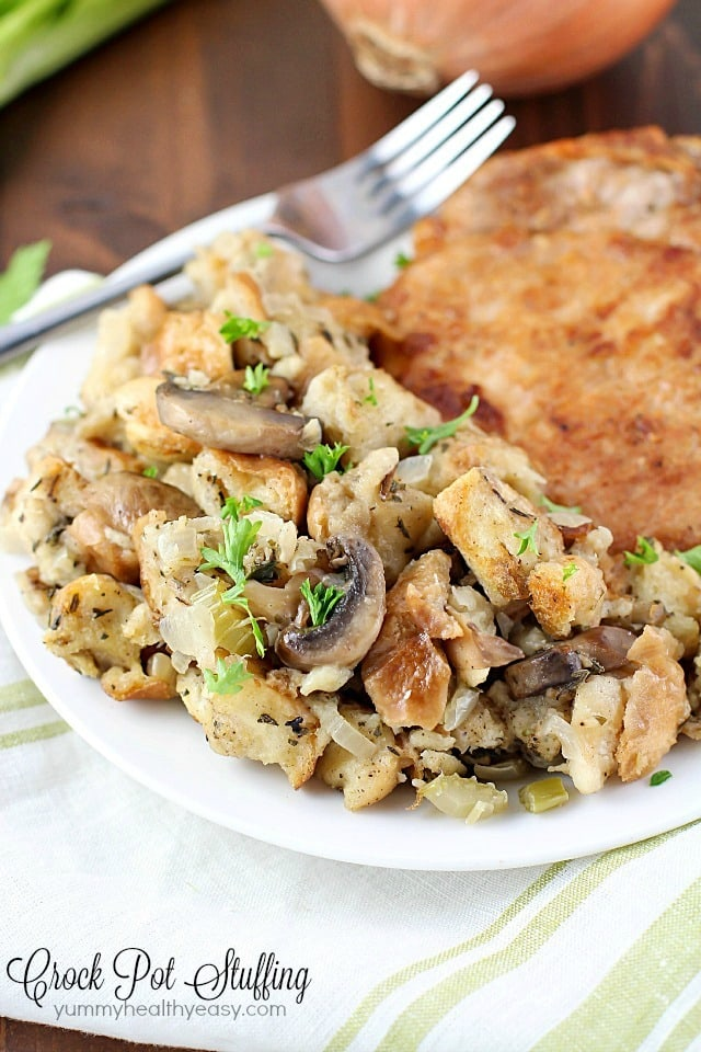 This Crock Pot Stuffing is delicious! So many great spices & flavors going on in this, it really stands out from those other blah stuffing recipes. Plus it's cooked in the slow cooker, so you can put it in hours before dinnertime and not even think about it until you eat! Perfect for Thanksgiving or any other day of the year!