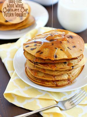 Flavorful pancakes full of pumpkin and chocolate chips that are also whole wheat and dairy-free! My family ate all of these and I had to make a second batch!