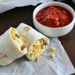 Freezer Breakfast Burritos are the best breakfast for busy people! Fix up a batch (so easy!) and throw in the freezer. When you're rushed to get out the door in the morning, throw a freezer breakfast burrito in the microwave and you're out the door with a healthy breakfast in minutes!