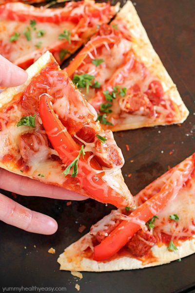 This Copycat Olive Garden Pepperoni & Sausage Flatbread Pizza is such a quick and easy dinner! Flatbread is layered with marinara sauce, roasted red peppers, pepperoni, sausage & cheese then baked. So easy and so delicious!! AD