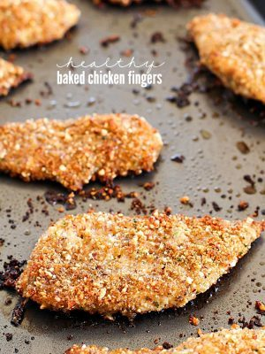 Healthy Baked Chicken Fingers with an almond-herb crust. These are my go-to easy dinner idea and my favorite way to eat chicken! They're incredibly flavorful and delicious! AD