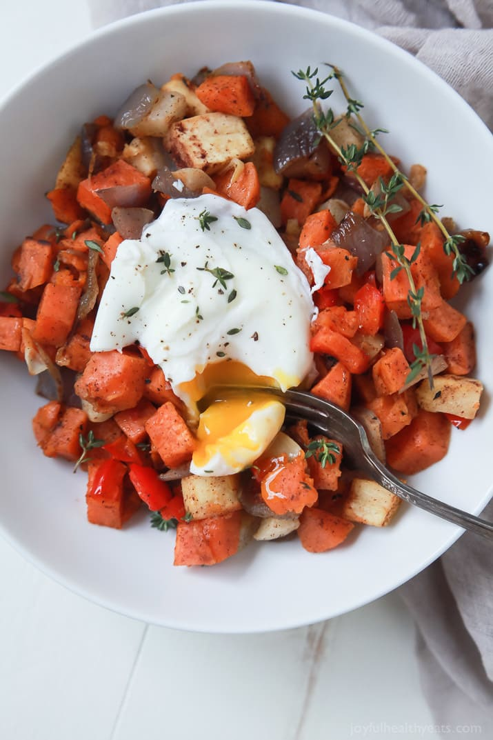An Easy Sweet Potato Hash topped with beautiful poached eggs. You'll ...