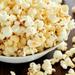 Homemade Kettle Corn that tastes like you bought it at the state fair AND it's totally easy to make! Only a few ingredients and a few minutes and you're enjoying kettle corn right at home!