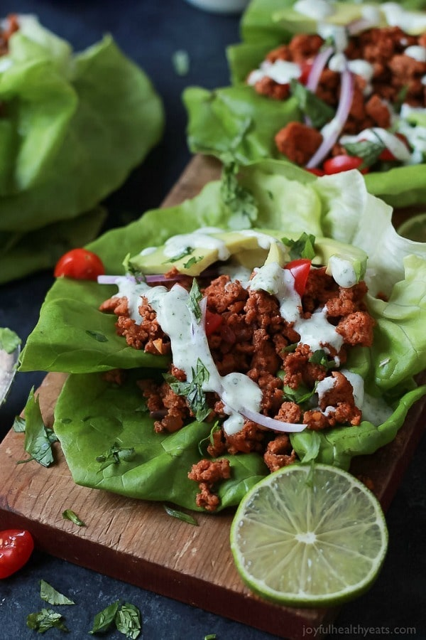 Ground Turkey Tacos in Lettuce Wraps topped with a fresh Cilantro Lime Crema – a great healthy weeknight meal option that's full of flavor and gluten free!
