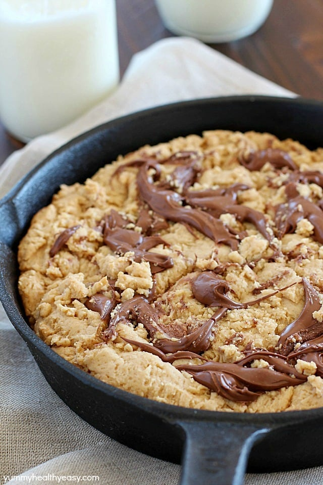 """How about a Skillet Cookie with a Nutella Swirl for dessert? Yes! A warm, lightened-up cookie with a Nutella swirl & a scoop of low-fat ice cream on top + a spoon! Just like a """"pizookie"""" at your favorite restaurant! PLUS 23 more amazing Nutella recipes that will have your mouth watering!"""