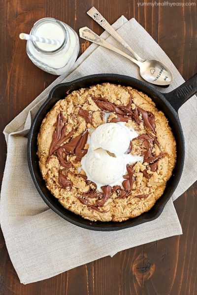 "How about a Skillet Cookie with a Nutella Swirl for dessert? Yes! A warm, lightened-up cookie with a Nutella swirl & a scoop of low-fat ice cream on top + a spoon! Just like a ""pizookie"" at your favorite restaurant! PLUS 23 more amazing Nutella recipes that will have your mouth watering!"