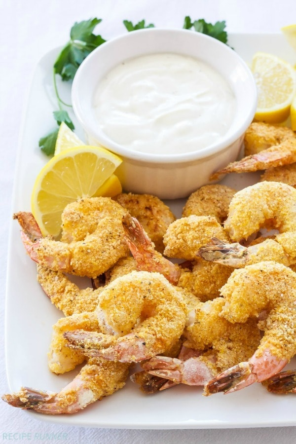 These crispy Cornmeal Crusted Shrimp with Light Lemon Aioli are a healthier alternative to the traditionally fried version. Even though it's baked you'll still achieve that crunch you're looking for!