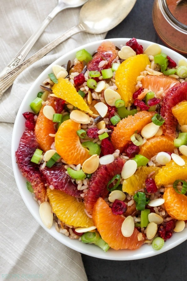 This Citrus and Wild Rice Salad is full of healthy whole grain wild rice, loads of citrus, crunchy toasted almonds, dried cranberries and a delicious citrus vinaigrette. A must-make!
