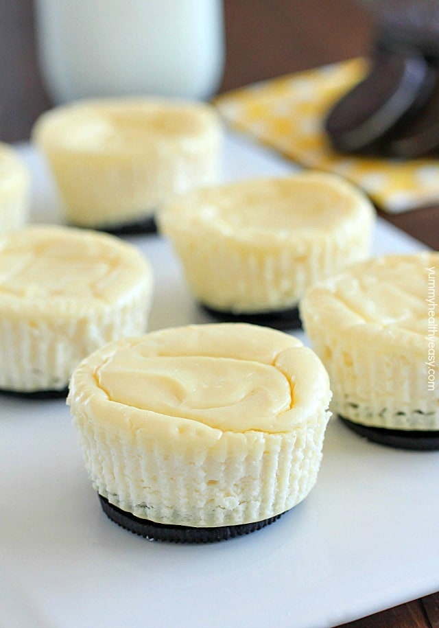 Mini Cheesecakes with an Oreo crust! This lighter recipe is absolutely delicious and super easy to make. Only a few ingredients & whipped up in a matter of minutes. With less calories than a regular cheesecake + built-in portion control with the muffin tin! These are a dessert worthy of guests or just for fun!