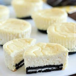 Mini Cheesecakes with an Oreo crust! This lighter recipe is absolutely delicious and super easy to make. Only a few ingredients & whipped up in a matter of minutes. With less calories than a regular cheesecake + built-in portion control with the muffin tin! These are a dessert worthy of guests or just for fun.