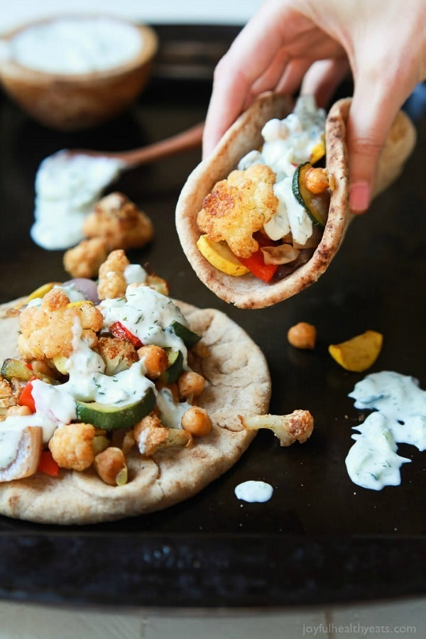 Moroccan Cauliflower Chickpea Pita – done in 35 minutes, filled with spiced roasted vegetables and covered in a creamy Tzatziki Sauce. A meal your family will love and perfect for meatless Monday!