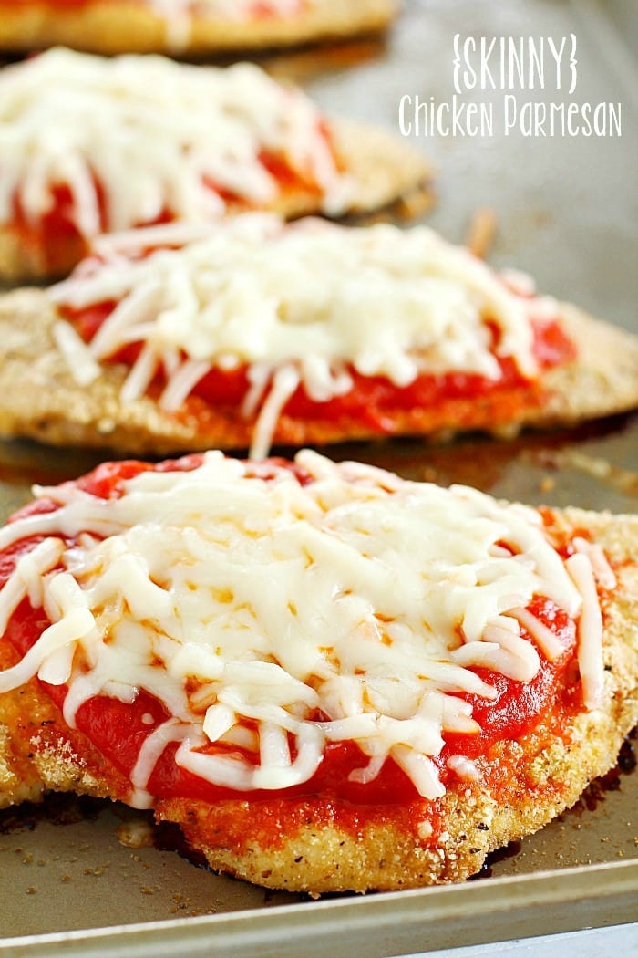 Time to change up that fattening Chicken Parmesan Recipe and make it skinny!! This lightened up comfort food dish is super easy to make and made healthier by baking instead of frying among other things. You need to add this Skinny Chicken Parmesan to your weekly dinner rotation!