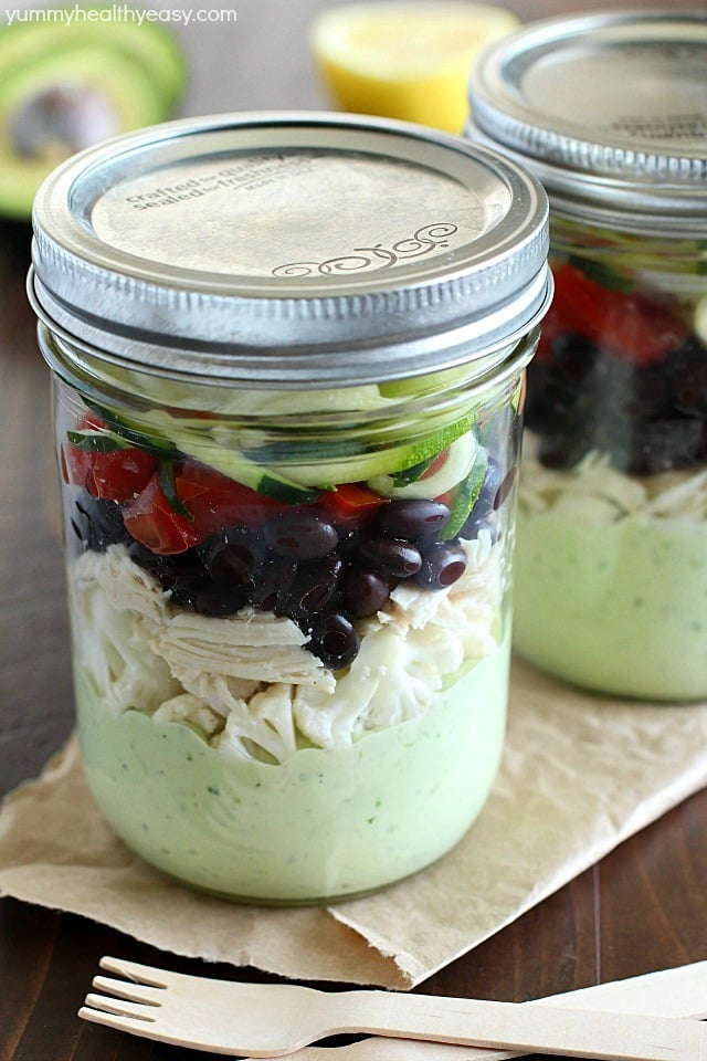 Avocado dressing (southwest style!) is nestled on the bottom of this delicious mason jar salad with zucchini noodles on the top and chicken, veggies and black beans tucked in the middle. A delicious and healthy low-carb, low-sugar lunch prepared ahead of time and eaten on-the-go! Plus a HUGE Blendtec Giveaway you won't want to miss!!