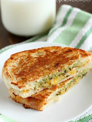 Pesto Grilled Cheese Panini is the easiest and tastiest grilled cheese sandwich pressed with two pans to make it a panini! You only need a few ingredients for this delicious sandwich full of flavor!