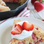 This Strawberry Skillet Corn Cake is full of strawberry goodness! It's super easy to make, with only a few ingredients and absolutely perfect to serve for brunch, dessert or a fun snack!