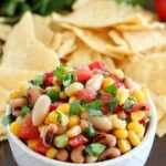A white bowl is filled with colorful Cowboy Caviar - 43 Healthy Snack Ideas