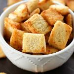 Garlic Parmesan Homemade Croutons are easy to make and cheaper than the store-bought kind! Tons of garlic parmesan flavor make these homemade croutons out of this world!!