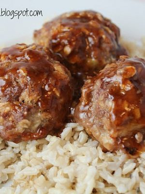 Sweet & Sour Meatballs – incredibly easy and delicious meatballs cooked with a yummy sauce right in the oven! Very little work involved for the perfect meatball dinner!