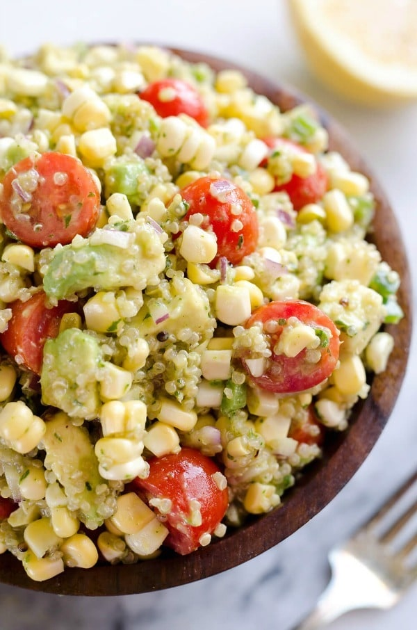 Cilantro Quinoa Corn Salad is a light and refreshing salad perfect for an easy packed lunch or a side salad for a cookout. This salad is a healthy combination of quinoa, corn, avocado and a light Cilantro Lemon dressing with a kick of spice from fresh jalapeños for a dish you will love!