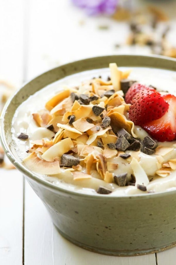 Dark Chocolate and Toasted Coconut Smoothie Bowl is a nutritious and fun twist on a smoothie! Filled with tropical flavors of banana and coconut then topped with dark chocolate, fruit, granola and chia seeds!