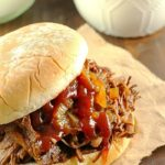 Slow Cooker Shredded Beef Sandwiches are one of my family's favorite make-ahead dinners! Cooked right in the crock pot with an easy & flavorful sauce, makes this beef roast tender and perfect for filling sandwiches/buns! Great to serve for dinner or for a party!