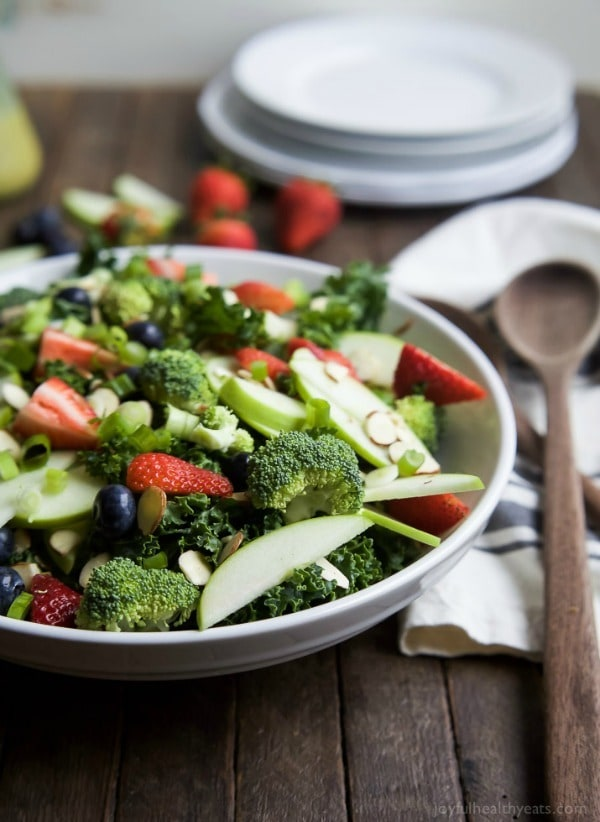 "A super healthy Detox Summer Salad filled with kale, broccoli, fresh berries, and almonds then topped with a ""lick your plate"" worthy Citrus Basil Vinaigrette! This salad is great for lunch or the perfect side to bring to your next BBQ!"