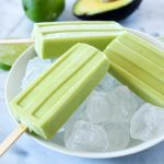 Creamy Avocado Coconut Popsicles - every bite is a tropical getaway! Who would have thought that avocado in a popsicle would be so delicious? You get a little coconut, lime and avocado in every bite of these popsicles! AD