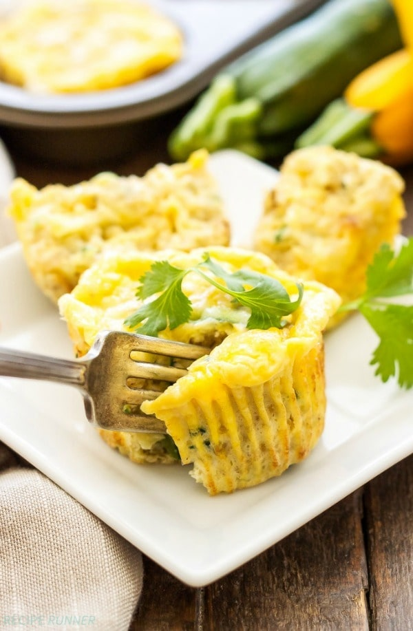 Full of protein and carbs, these healthy, freezer friendly, Cheesy Zucchini Quinoa Egg Muffins are the perfect way to start the day!