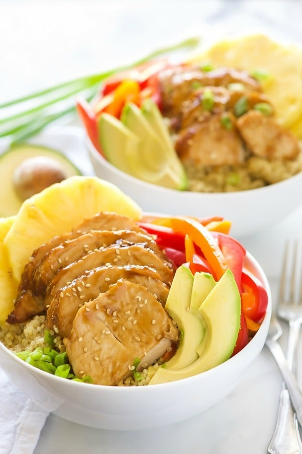 Honey Soy Glazed Hawaiian Bowls pack a serious flavor punch! Honey soy glazed turkey tenderloins are baked then added to a bowl filled with rice, juicy pineapple, peppers, onions, and avocados.