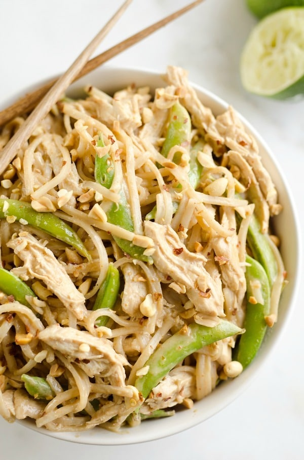 Pressure Cooker Thai Peanut Chicken & Noodles - lean chicken breasts are cooked in a homemade spicy Thai peanut sauce and finished off with rice noodles and peas for an easy and healthy one-pot meal!