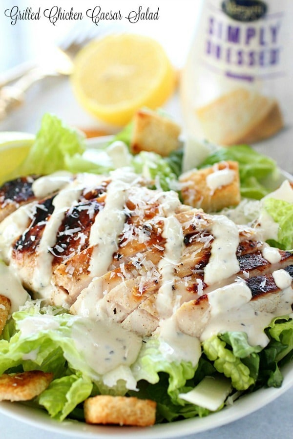 Grilled Chicken Caesar Salad – with a simple marinade recipe, this grilled chicken is tender and delicious! Served over romaine, shaved parmesan, homemade croutons & caesar dressing.