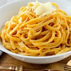 Creamy Pumpkin Pasta that's vegetarian, skinny and absolutely delicious! You won't believe the flavor pumpkin can add to a pasta sauce. This easy and healthier pasta sauce is great with any type of pasta or even zucchini noodles (zoodles)! Plus 22 more fabulous pasta recipes to celebrate National Pasta Day!
