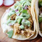 Pork Verde Tacos cooked in the crock pot and served with a drizzle of amazing jalapeño sauce. You will love the flavor in these pork tacos and love how easy they are to make! AD