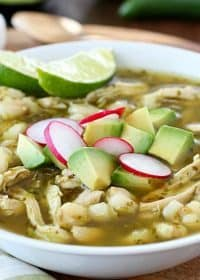 This Chicken Posole Verde Recipe has shredded chicken and tender hominy in a crazy flavorful verde broth! Such wonderful flavor in the verde sauce, you won't even believe it! This soup is best served with radishes, cilantro, avocado, queso fresco and/or tortilla chips. (Skip the chips to keep this gluten free!) AD