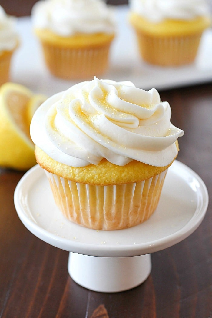 Lemon Cupcakes made with only 2 Ingredients and then frosted with a quick and easy lemon frosting! You won't believe how soft and delicious these cupcakes are! Plus a round-up of more delicious cupcake recipes you won't want to miss!