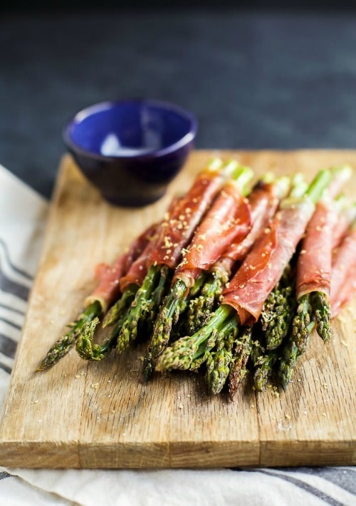 Prosciutto Wrapped Asparagus – one of the easiest recipes you'll make using just two ingredients! Perfect for an appetizer, snack, or side dish for the holidays!