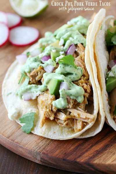 Celebrate Taco Tuesday with these Crock Pot Pork Verde Tacos served with a drizzle of amazing jalapeño sauce. You will love the flavor in these pork tacos and love how easy they are to make!