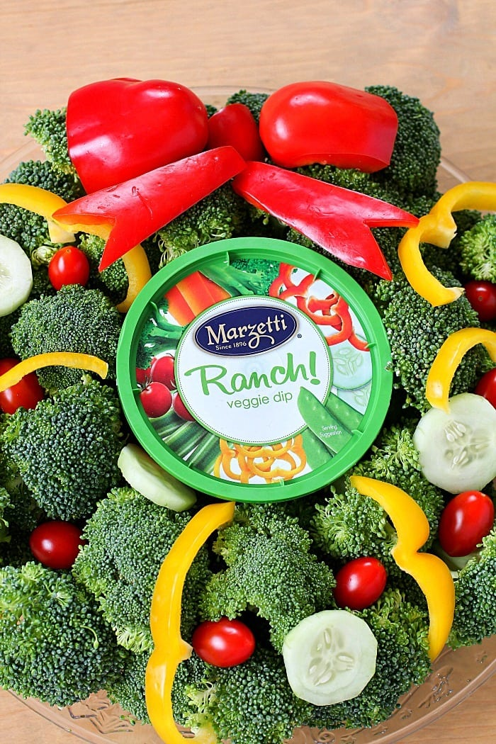 Turn your boring veggie tray into something cute for the holidays with this Christmas Wreath Holiday Veggie Tray! It's simple to make but will leave a lasting impression on your guests at any holiday party! AD