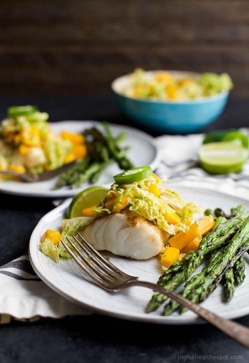 Grilled White Fish topped with a refreshing Mango Jalapeno Coleslaw that will blow more than your socks off! Incredible flavor, minimal ingredients with less than 20 minutes to prepare!