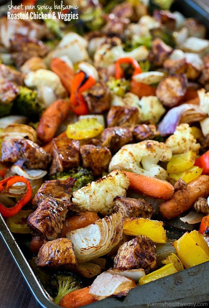 Sheet Pan Spicy Balsamic Roasted Chicken & Veggies for the WIN!! This dinner is full of fiber-filled veggies and lean chicken, tossed in a spicy balsamic sauce and then baked on a sheet pan. Easy peasy and gluten free, paleo and clean eating!