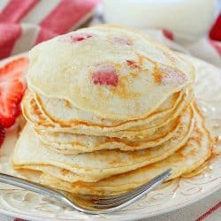 Start your day right with a stack of Strawberry Pancakes! They're a quick and easy to make breakfast the whole family will love!