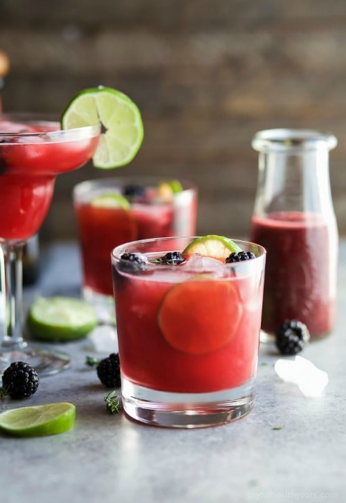 Thyme Blackberry Margaritas, as gorgeous as they are delicious! This is one smooth margarita with a hint of citrus, blackberry flavor and subtle notes of fresh thyme! You're gonna fall in love!