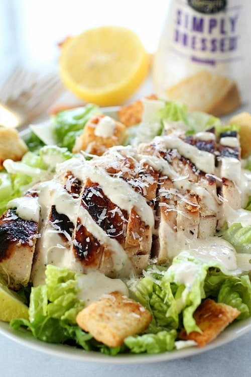 Grilled Chicken Caesar Salad – with a simple marinade recipe, this grilled chicken is tender and delicious! Served over romaine, shaved parmesan, homemade croutons & Marzetti Simply Dressed Caesar Dressing = YUM!!