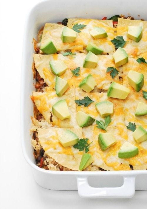 This simple, vegetarian Mexican Lasagna is a family favorite recipe! It still hits that comfort feeling you're looking for, just with healthier ingredients like brown rice, spinach, beans, and peppers.