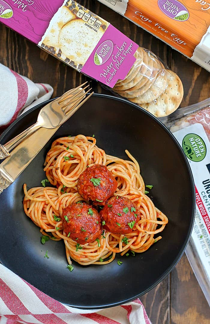The perfect combination of bacon and beef is Bacon Meatballs! An overview shot of these easy Bacon Meatballs on a bed of pasta.