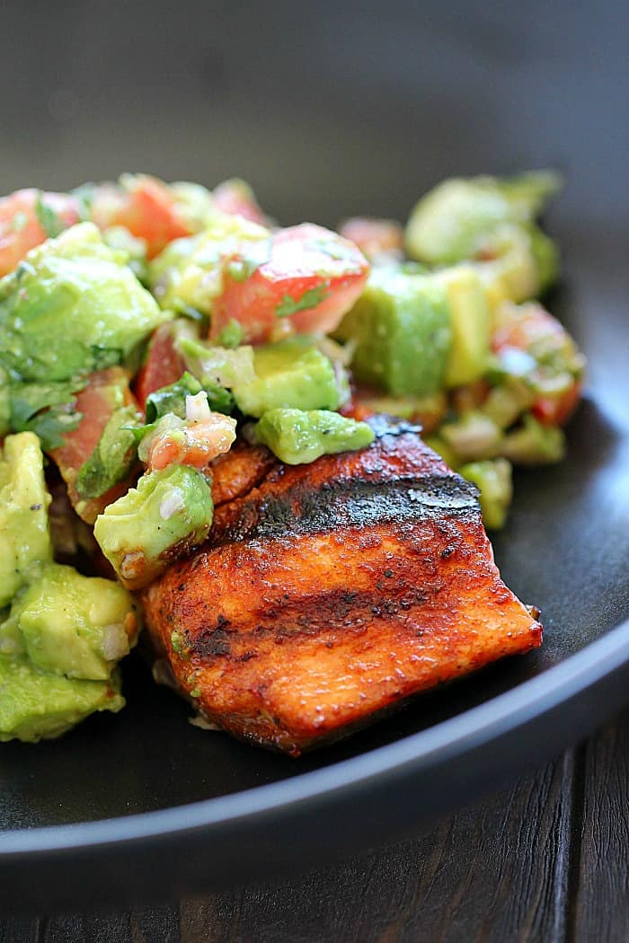 The whole family will go crazy for this Spicy Grilled Salmon with Avocado Salsa! Easy and quick to make and tastes like restaurant quality!