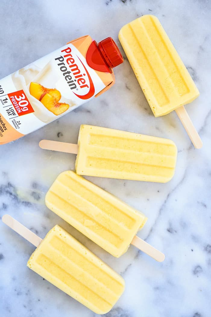 You HAVE to try these Tropical Protein Popsicles Recipe! They're SO good! Only a couple of ingredients for a crazy delicious protein popsicles! #AD